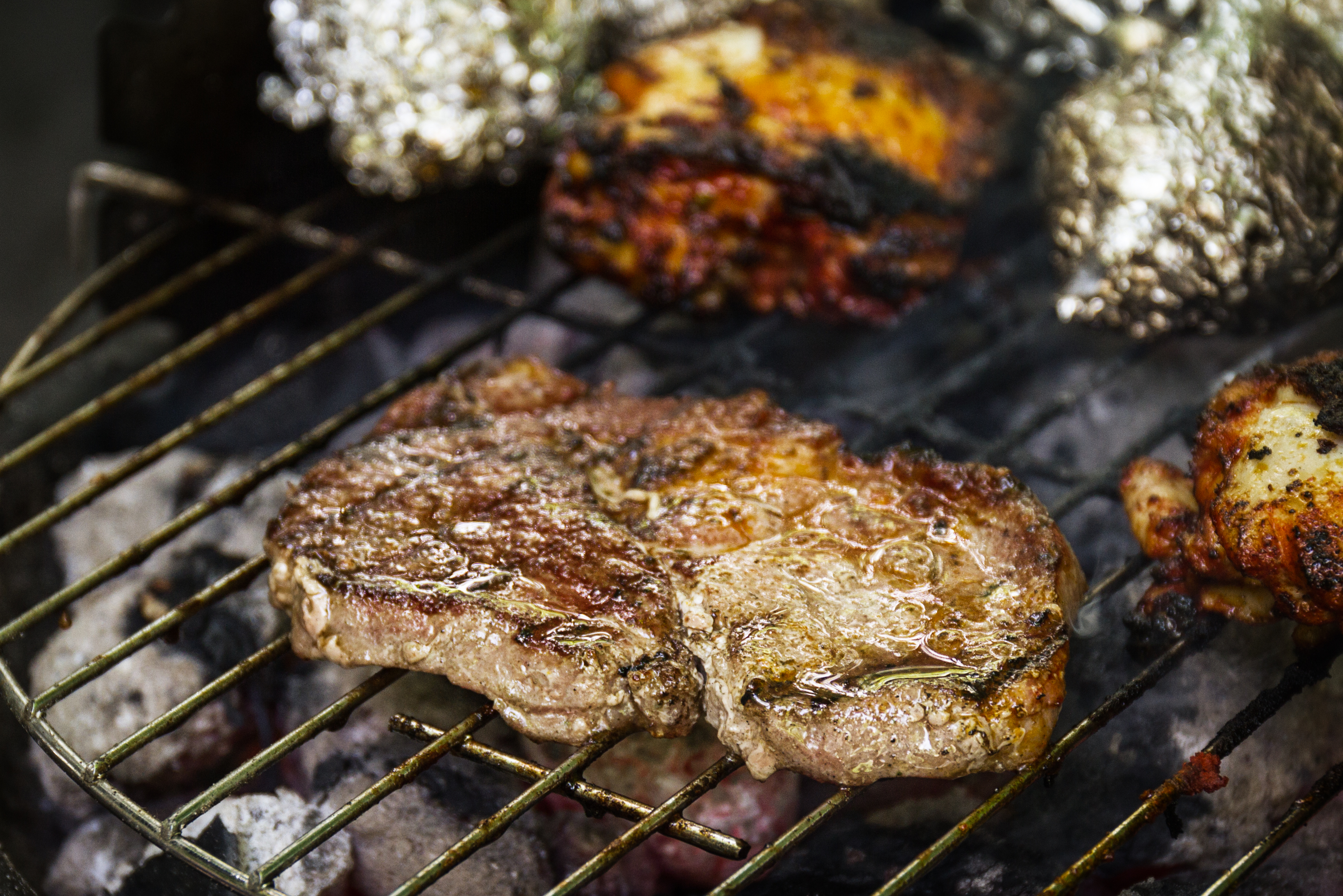 grilling meat on bbq pits