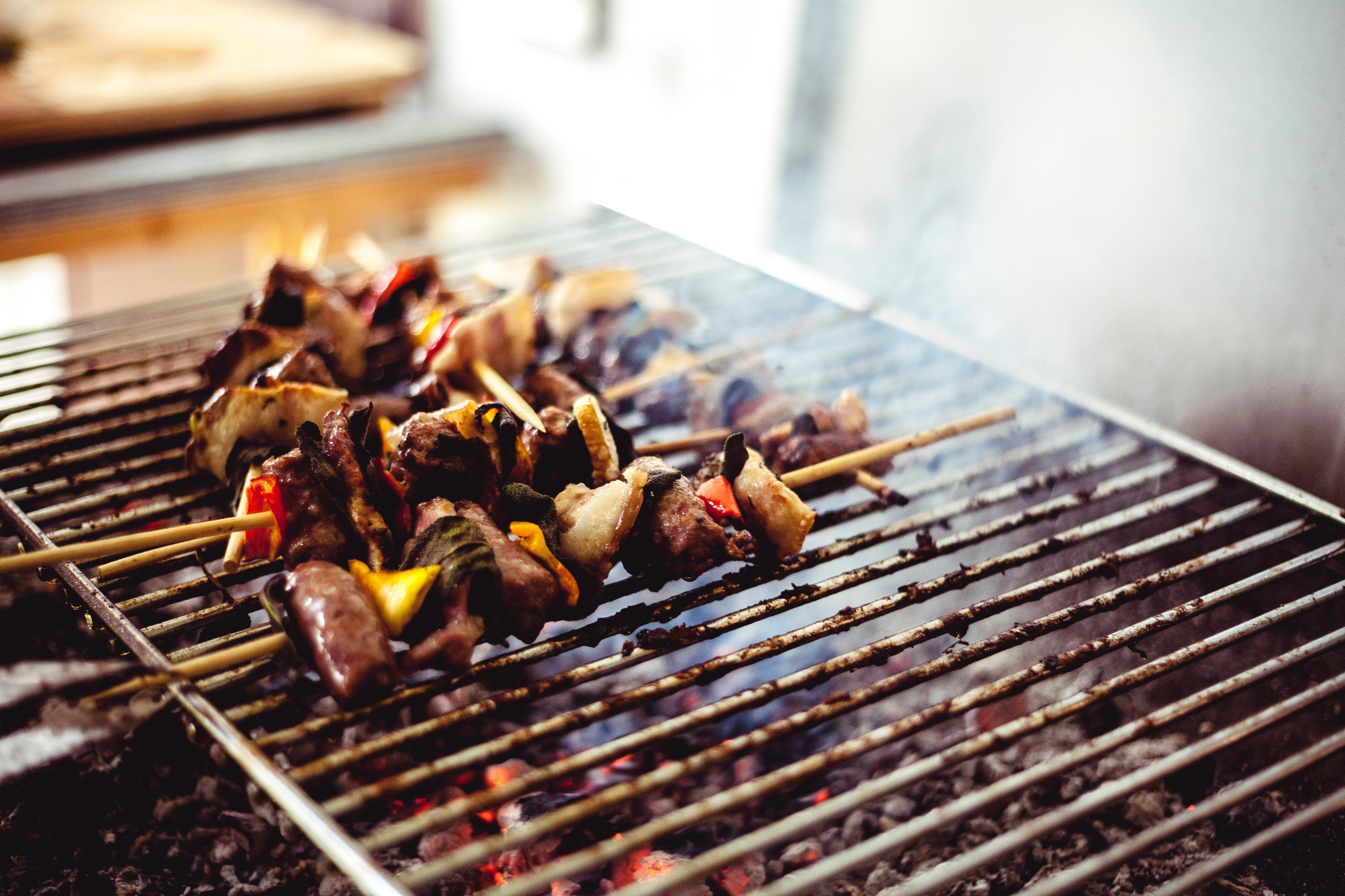 grilling assorted skewers on bbq pits